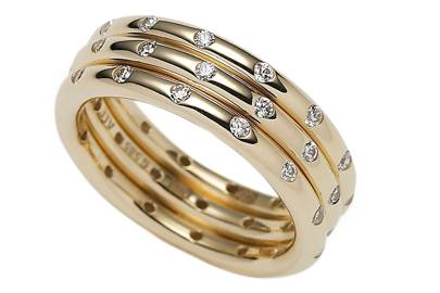Gold & cubic-zirconia rings, £275 each, by Pandora