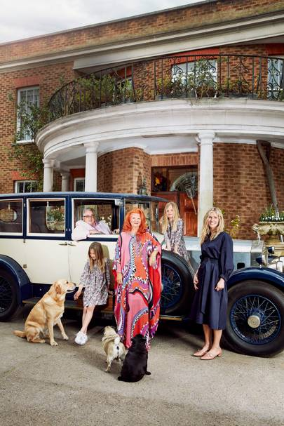 Sir William (in his vintage Rolls-Royce) and Lady McAlpine, with, [i]from left[/i], her granddaughters Matilda and Poppy and her daughter Vicky plus Boris the Labrador and pugs Alice and Algie.