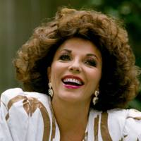 1987: Smiling brightly, despite divorcing from her fourth husband, Peter Holm