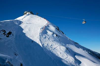 A cable car approaches Piz Gloria, the rotating restaurant on the summit of the Schilthorn.