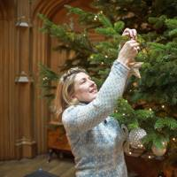 The Countess of Carnarvon decorating the tree at Highclere