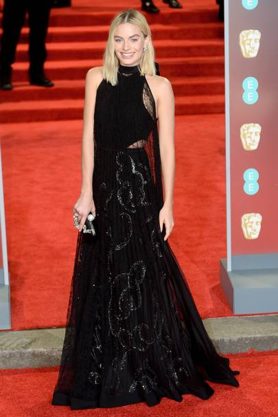 Margot Robbie in Givenchy Haute Couture and Roger Vivier Boite de Nuit bag