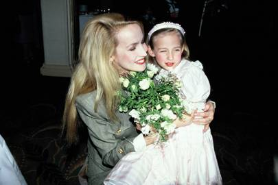 With mum Jerry Hall, in 1990