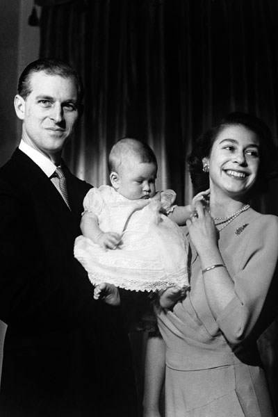 The Duke of Edinburgh with Princess Elizabeth holding Prince Charles, aged six months, 1949
