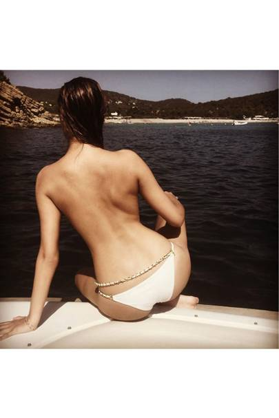 Amber Le Bon's bikini top must have got lost in transit (2015)
