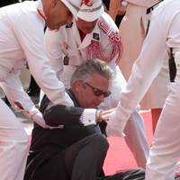 Prince Laurent is helped after a fall, 2011