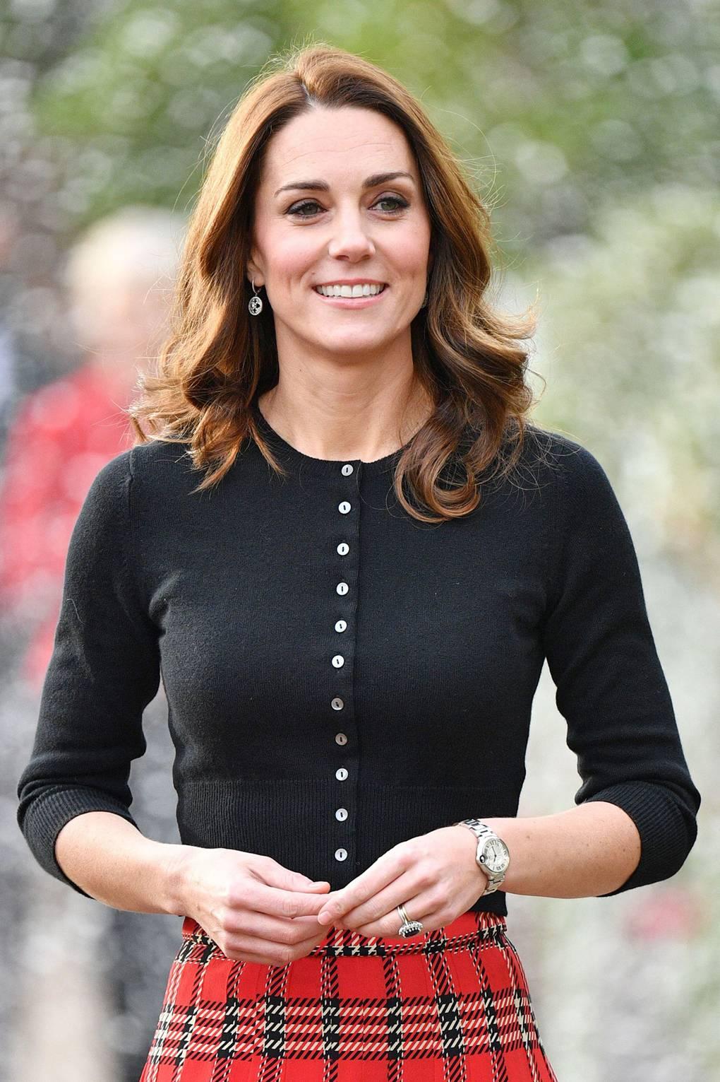 7a94cde81 The Duchess of Cambridge wears tartan skirt for Christmas party | Tatler