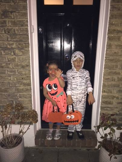 Minty Singh as a pumpkin and Levi Singh as a mummy