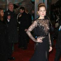 Surviving a Dress Which Looks as Though it's Eating You from the Inside Out Prize: Amy Adams