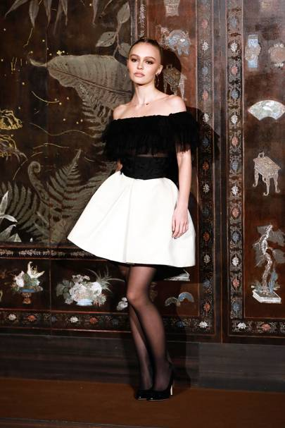 Lily Rose Depp wearing Chanel to the Chanel Metiers D'Art 2019-2020