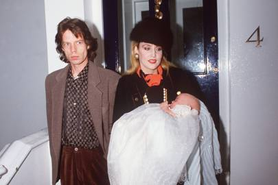 With Mick Jagger and Jerry Hall at her christening, 1984