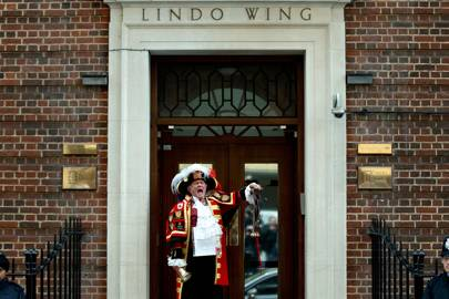 A town cryer announces the birth outside the Lindo Wing