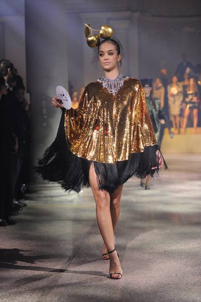 Jasmine Sanders in a gold Alan Journo headpiece, 2014, and a Dolce & Gabbana sequinned cape, 2011