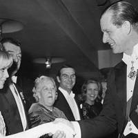 Prince Philip shakes hands with Swedish actress Britt Ekland, 1964