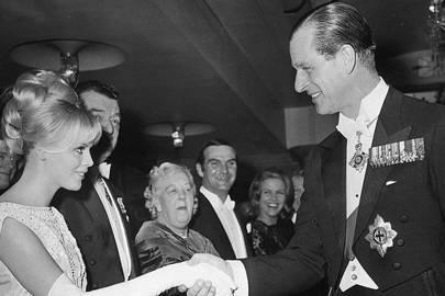 Prince Philip shakes hands with Swedish actress Britt Ekland, 1964
