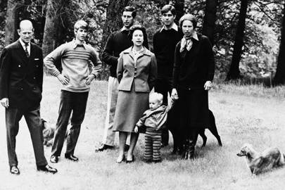 Prince Philip, Prince Edward, Prince Charles, the Queen, Prince Andrew and Princess Anne, holding the hand of Master Peter Phillips, 1979