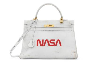 11c72de7ea48 Hermès, 1996, executed in 2009. A rare and unique painted white   red  ardennes leather Nasa Retourne Kelly 35 with gold hardware by Tom Sachs.