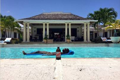 Tinie Tempah sunbathing in Jamaica with a not-at-all-carefully-positioned bottle of Red Stripe (2014)