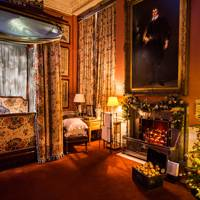 Scrooge in bed in the Scots Bedroom at Chatsworth