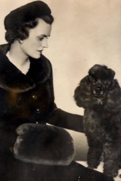 With her pet poodle Louis XIV in 1957
