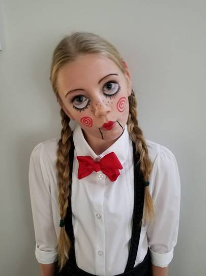 Emily Haynes as a creepy doll