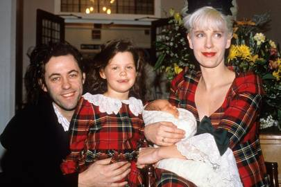 As a baby with parents Bob Geldof and Paula Yates, and with big sister Fifi Trixie-Belle