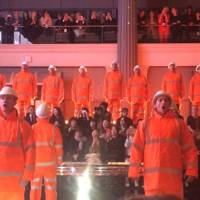 Singing male models in workmen's outfits. Life doesn't get much better than this.