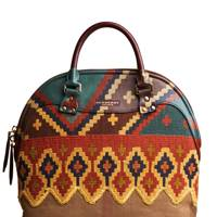 Canvas & leather bag, £2,995, by Burberry