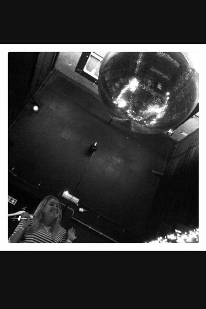 In case there's any doubt we're in a club: a disco ball the size of a PLANET.