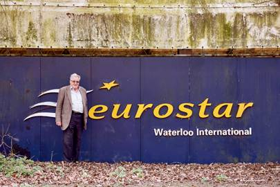 Sir Bill in front of the original Waterloo station Eurostar sign, one of his many pieces of railway memorabilia.
