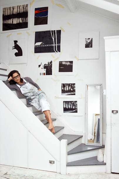 Suzy on the stairs in her studio.